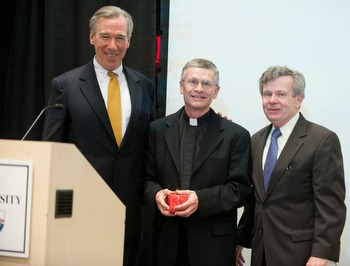 Catholic University President John Garvey (L) and Provost James Brennan (R) congratulate Father Matera on his retirement from the school at the Spring Faculty Luncheon.